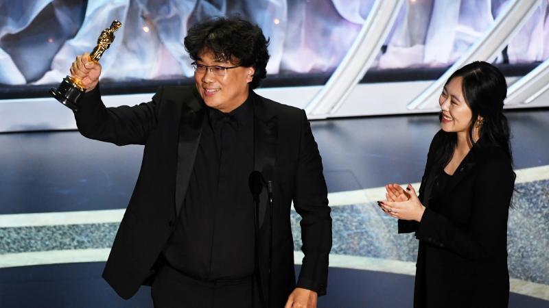 Bong Joon-ho, here with interpreter Sharon Choi, won big at Sunday's Oscars. His film Parasite took best international feature and best picture, and he was recognized for his direction and writing.
