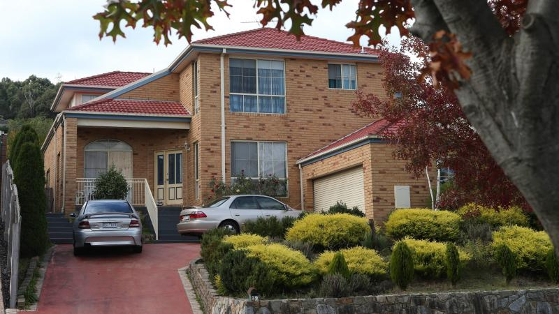 Police made one of several arrests at this house in Narre Warren, a suburb of Melbourne, Saturday. Police raided houses in the city's outer eastern suburbs and made several arrests over an alleged attack planned for ANZAC Day.