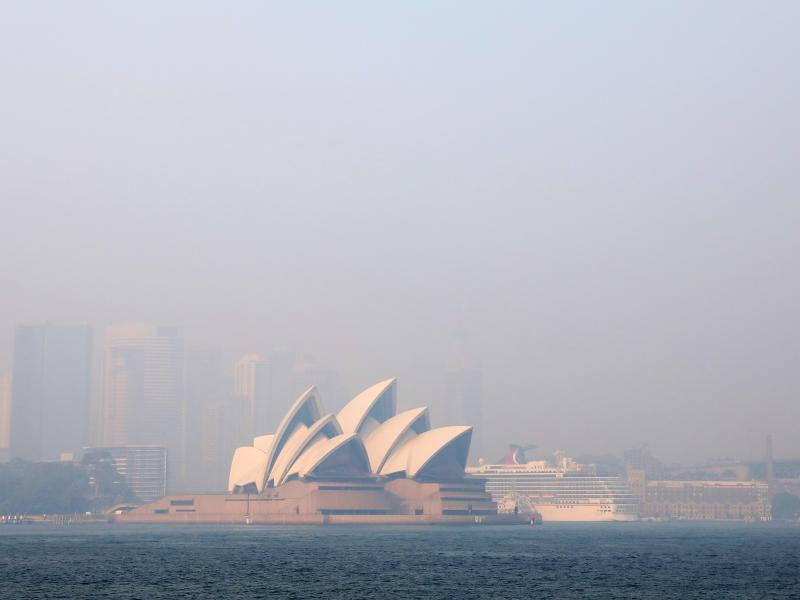 Much of New South Wales, Australia, including the Sydney Opera House, lay under a shroud of smoke Thursday. The state remains under severe or very high fire danger warnings as more than 60 fires continue to burn within its borders.