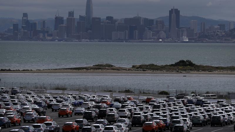 New cars sit in a lot at the Auto Warehousing Co. near the Port of Richmond in Caliornia last year. President Trump has threatened to impose heavy tariffs on auto imports, but the White House has not announced a decision.