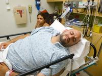 Michael Granillo and his wife Sonia await treatment at an emergency room in Northridge, Calif.