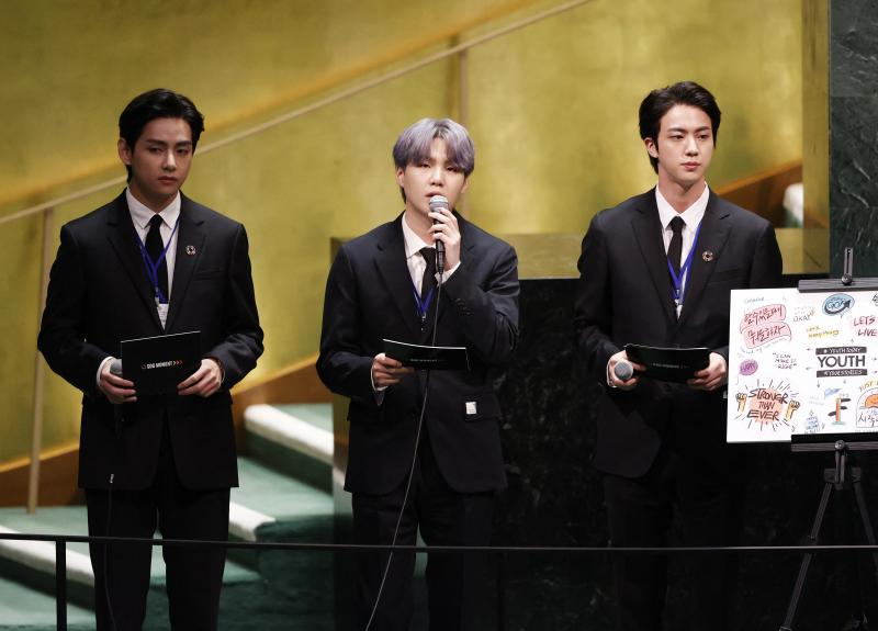 V (from left), Suga and Jin of BTS at the launch of the U.N. General Assembly's 76th session on Monday. The popular boy band from South Korea sang (in a video performance viewed online by more than 1 million) and spoke.