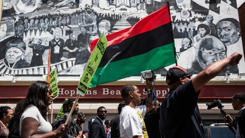 Protesters march from the Gilmor Homes, where Freddie Gray was arrested, to City Hall on Saturday in Baltimore.