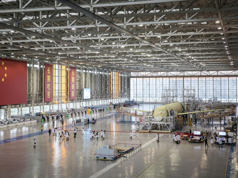 """A Commercial Aircraft Corp. of China Ltd. C919 aircraft stands under assembly in Shanghai in 2017. Proposed U.S. tariffs take special aim at the """"Made in China 2025"""" plan, which supports development of advanced technologies in fields such as artificial in"""