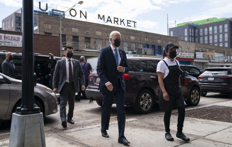 President Biden arrives for a visit to Taqueria Las Gemelas restaurant in Washington as part of the opening of the Restaurant Revitalization Fund, an coronavirus relief effort that opened this week.