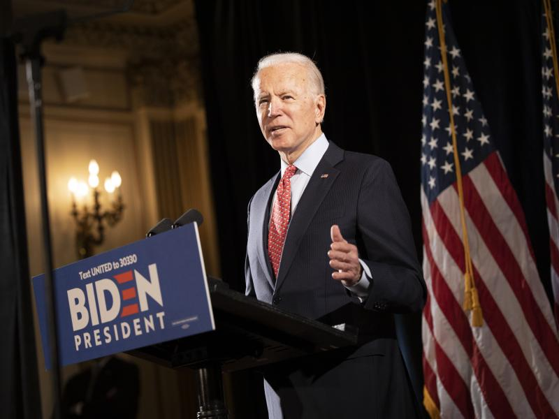 "Former Vice President Joe Biden at a press conference in Wilmington, Del., in mid-March. His bid this week to allow 60-year-olds to get Medicare ""reflects the reality,"" he says, ""that, even after the current crisis ends, older Americans are likely to find"