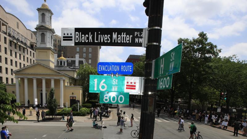 """A new street sign sits above an intersection outside St. John's Church in Washington, D.C., where President Trump arranged a photo-op this week. Mayor Muriel Bowser says, """"The section of 16th [Street] in front of the White House is now officially 'Black L"""