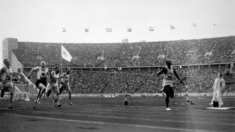 Jesse Owens crosses the line to win the 100-meter dash, one of four gold medals he won at the 1936 Olympics in Nazi Germany. The new book Upon Further Review imagines 31 counterfactual scenarios in sport, including the possibility of the United States boy