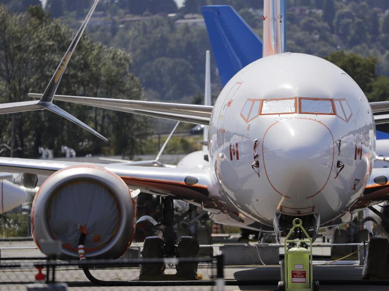 A grounded Boeing 737 Max sits in a parking area adjacent to Boeing Field in Seattle. Federal safety officials said on Thursday that Boeing should consider how cockpit confusion can slow the response time of pilots.