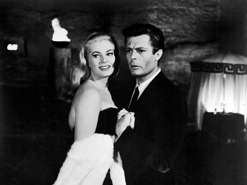 Italian actor Marcello Mastroianni and Swedish actor Anita Ekberg hold hands in a scene from Federico Fellini's 1960 film La Dolce Vita.