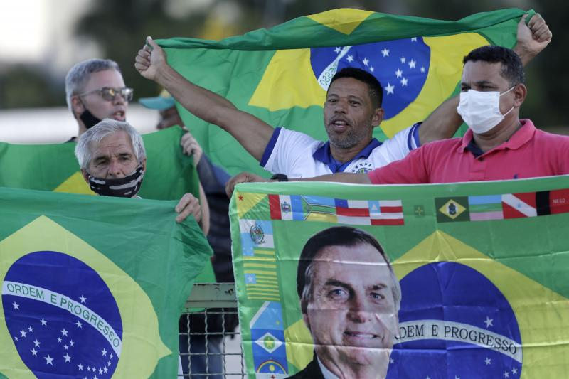 Demonstrators show support for Brazilian President Jair Bolsonaro in front of the presidential palace Monday in Brasilia. Bolsonaro reshuffled his Cabinet amid turmoil in his administration and dropping approval ratings over the coronavirus pandemic.