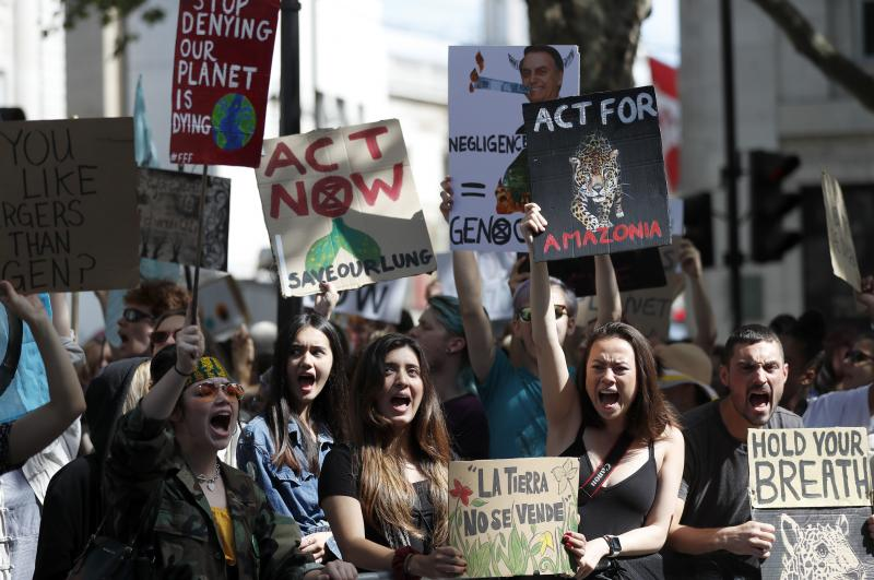 Extinction Rebellion activists protest outside the Brazilian Embassy in London on Friday, calling on President Jair Bolsonaro to act to protect the Amazon rainforest. The European Union is throwing its weight behind French President Emmanuel Macron's call