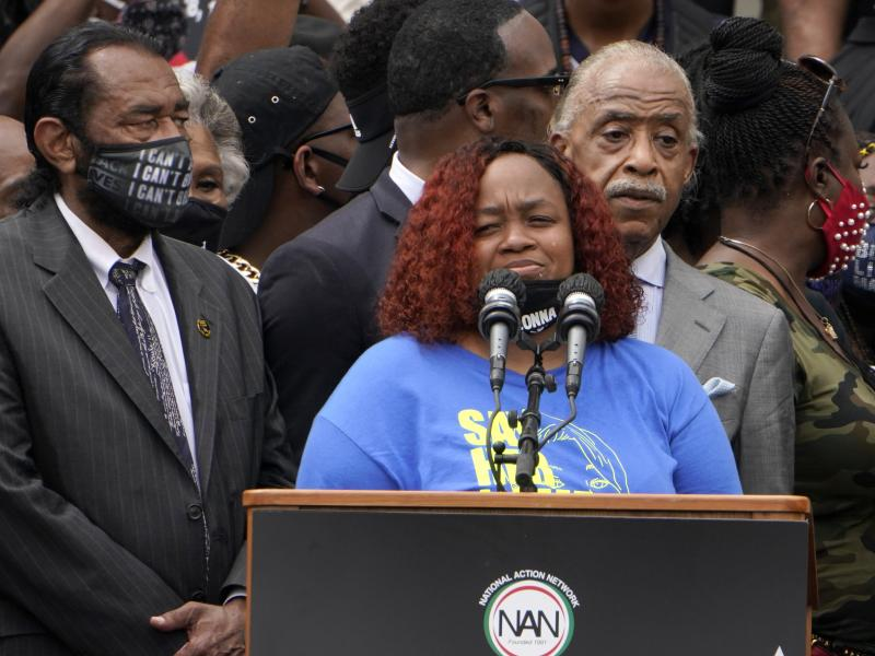Tamika Palmer spoke at the March on Washington last month at the Lincoln Memorial in Washington, D.C. At left is Rep. Al Green, D-Texas, and at right is the Rev. Al Sharpton.