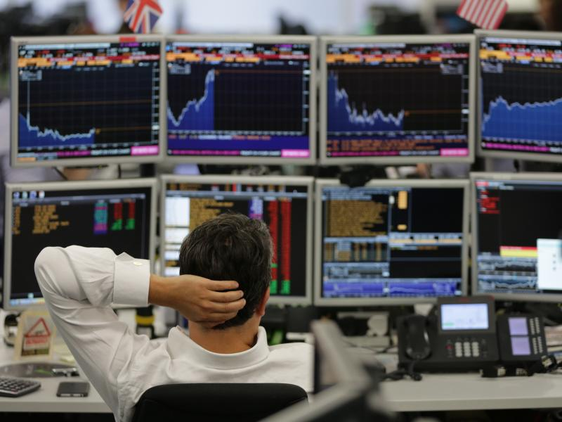 Traders at work at ETX Capital work in central London on Monday. Financial markets in the U.K. and around the world have been in turmoil since the Brexit vote last week.