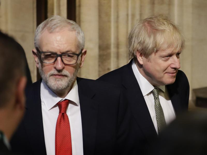 Labour Party Leader Jeremy Corbyn and British Prime Minister Boris Johnson walk through the Commons Members Lobby after hearing the Queen's Speech in Parliament last week.