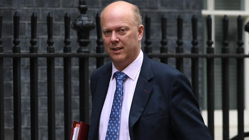 British Transport Secretary Chris Grayling, seen here after a Cabinet meeting at 10 Downing Street, is seen opening his car door on a passing cyclist in a video that was captured by a bike rider in London.