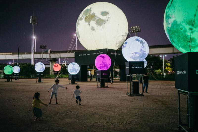 A day before the Chuseok holiday, children run around artificial full moons, part of an installation at a park in eastern Seoul. Koreans believe that wishes made to the full moon on Chuseok will come true. The Seongdong District Office teamed up with loca
