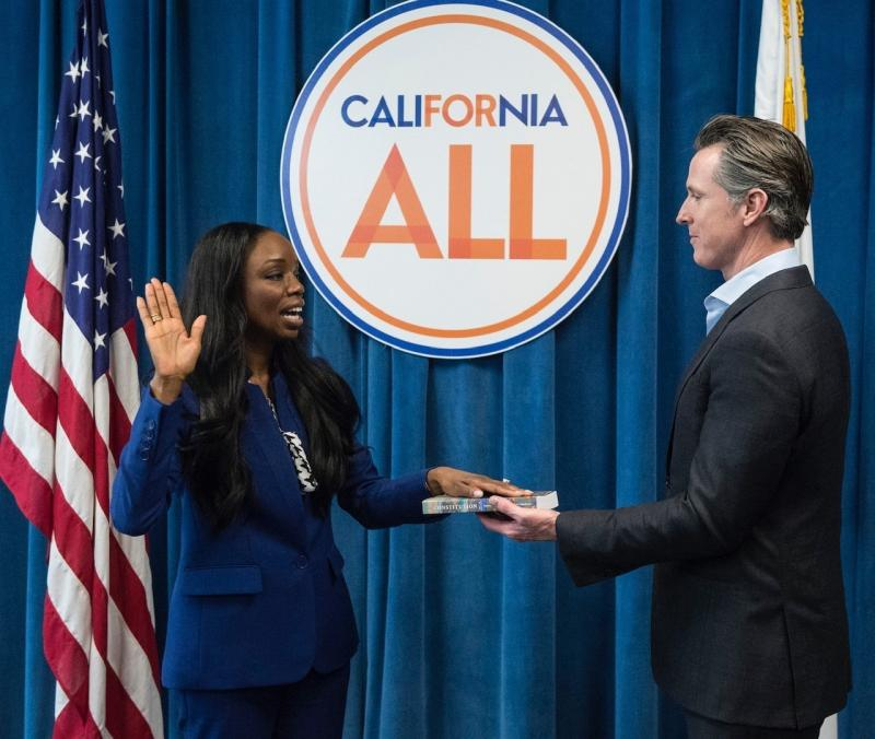 California's first surgeon general, Dr. Nadine Burke Harris, is sworn in by Gov. Gavin Newsom in February 2019. A leading voice on health care equity, she's helping shape the state's vaccination makeover following its rocky start.