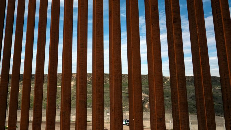A section of the U.S.-Mexico border fence as seen from Tijuana, Mexico. California's governor plans to split his state's National Guard troops on the border into three new deployments.