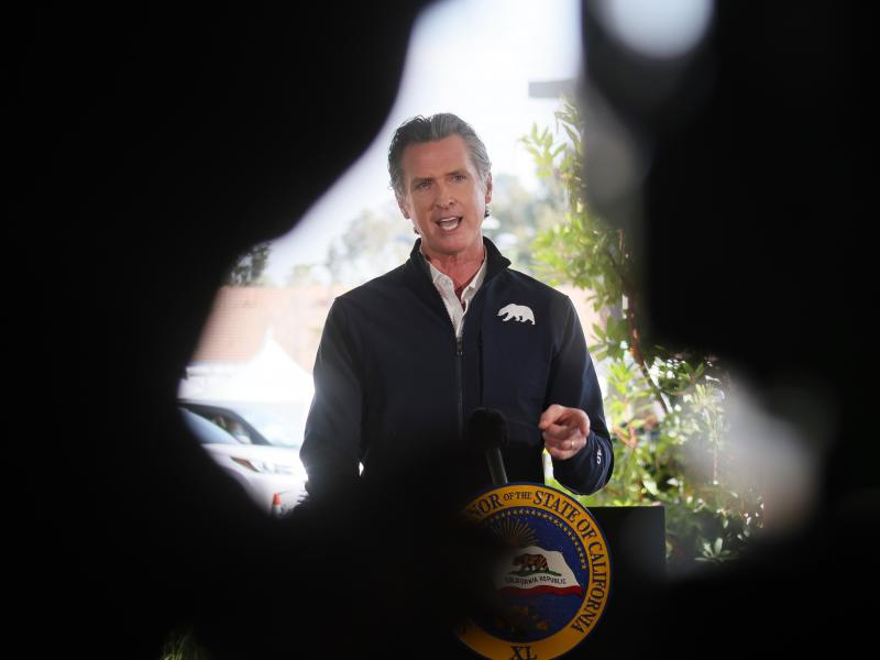 California Governor Gavin Newsom speaks at a press conference following the opening of a new large scale COVID-19 vaccination site in Los Angeles on Tuesday. Newsom says the state will start setting aside 10% of its vaccine allotment for teachers, day car