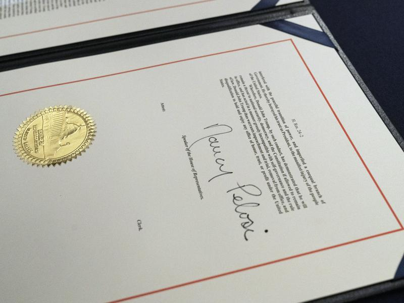 House Speaker Nancy Pelosi's signature is seen on the single article of impeachment against President Trump. The case against the president now moves to the U.S. Senate, which will consider the article after Trump is no longer in office.