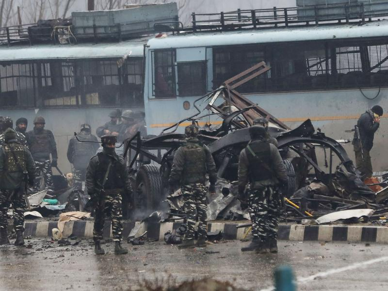 Indian security forces inspect the remains of a vehicle following an attack on a Central Reserve Police Force convoy that killed at least 44 officers and injured several others in Kashmir south of Srinagar on Thursday.