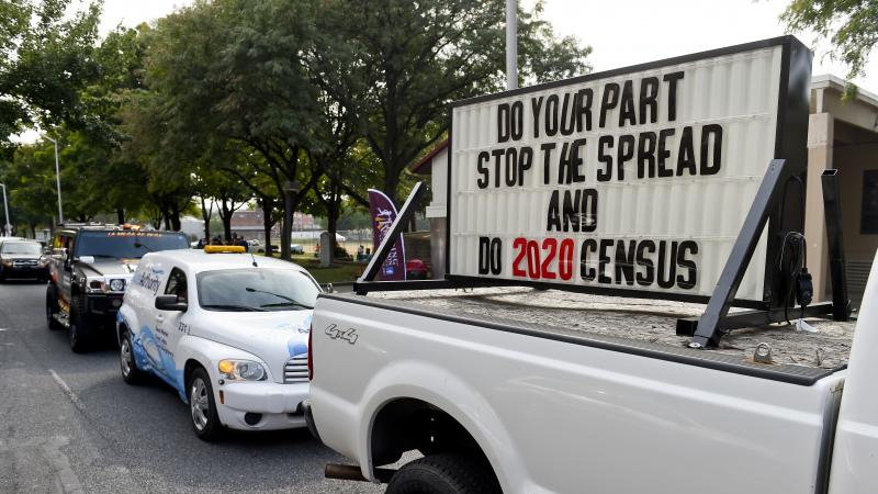 """A sign on the back of a truck promotes 2020 census participation in Reading, Pa. A day after the Census Bureau announced a new """"target date"""" for ending counting efforts, a federal judge in California said she thinks the schedule is """"a violation"""" of her co"""
