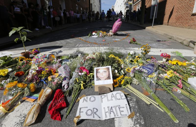A makeshift memorial of flowers and a photo of victim Heather Heyer sits in Charlottesville, Va., on Aug. 13, 2017. Heyer died when a car rammed into a group of people who were protesting white supremacists who had gathered in the city for a rally.