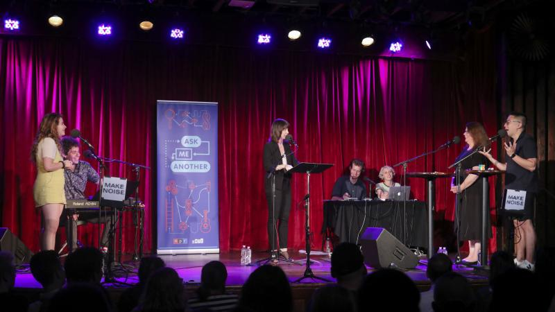 Contestants and comedian Bowen Yang compete in Ask Me Another's final round at the Bell House in Brooklyn, New York.