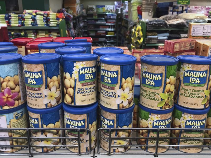 Imported nuts from the United States are displayed for sale at a supermarket in Beijing on Monday. China raised import duties on U.S. pork, fruit and other products Monday.
