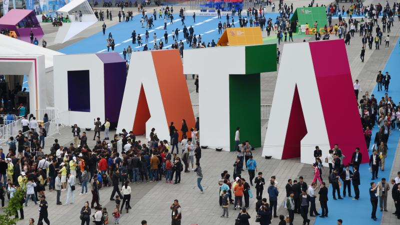 """Visitors walk past the giant word """"Data"""" during the Guiyang International Big Data Expo 2016 in southwestern China. China says it's determined to be a leader in using artificial intelligence to sort through big data. U.S. officials say the Chinese efforts"""