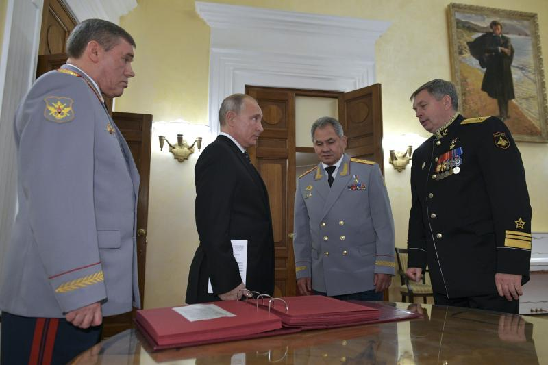 Russian President Vladimir Putin (second from left) meets military officials, including Igor Kostyukov (far right), the deputy chief of military intelligence for the GRU. The 2018 event in Moscow marked the centenary of the GRU, which has been involved in