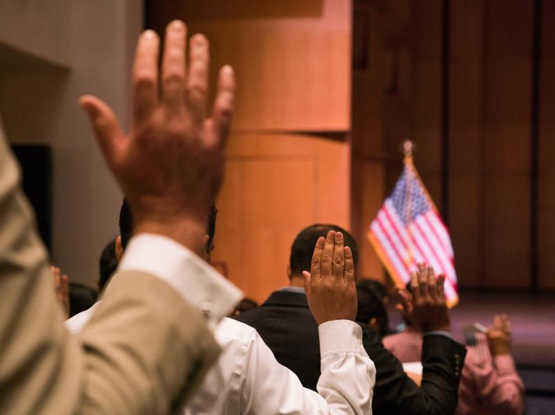 Newly sworn-in U.S. citizens gather for a naturalization ceremony at the Rachel M. Schlesinger Concert Hall and Arts Center in Alexandria, Va., in August. The Trump administration is planning to include a question about U.S. citizenship status on the 2020