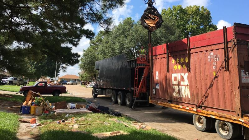 Cleanup crews roll through East Baton Rouge picking up debris from massive floods that ravaged the state last week.