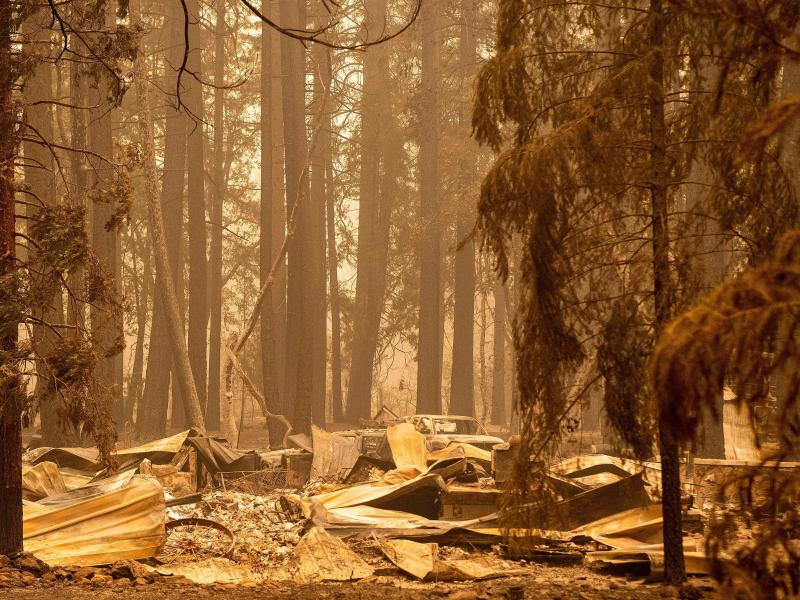 The remains of a burned home are seen in the Indian Falls neighborhood of unincorporated Plumas County, California on July 26, 2021. Extreme weather events have claimed hundreds of lives worldwide in recent weeks, and upcoming forecasts for wildfire and h