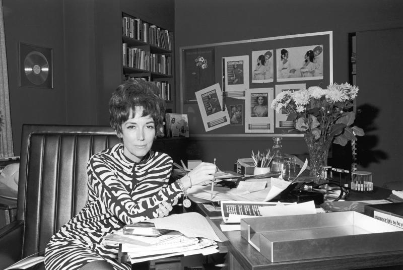 """Helen Gurley Brown in her office at Cosmopolitan magazine in the 1960s .The legendary editor, subject of two new biographies, knew sex sells – and food brings in ad money. She cannily combined them with features like """"After Bed, What? (a light snack for"""