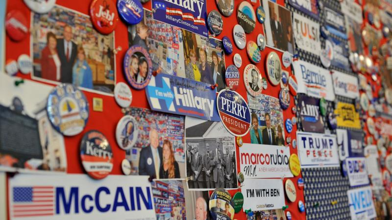 A collection of current and past presidential advertising materials hangs on a wall in the visitor center of the New Hampshire State House in Concord, N.H.