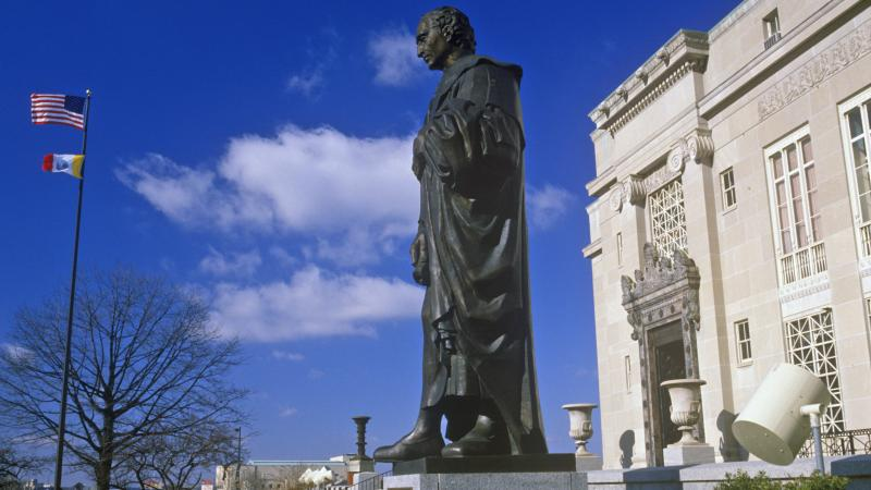 Columbus announced last week that it won't be closing for business, saying it prefers to emphasize Veterans Day instead. Here, a statue of Christopher Columbus is seen in a file photo, standing outside the Columbus City Hall.