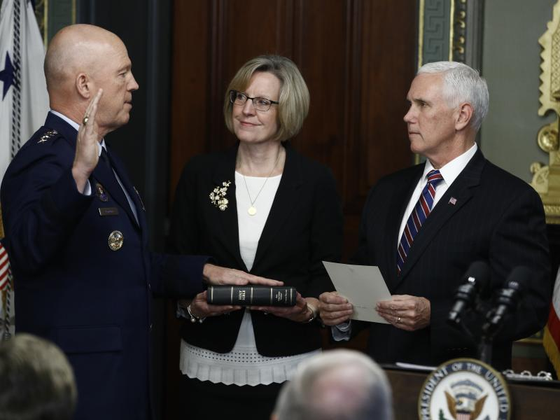 Vice President Pence (right) swears in Air Force Gen. John Raymond as Chief of Space Operations on Tuesday.