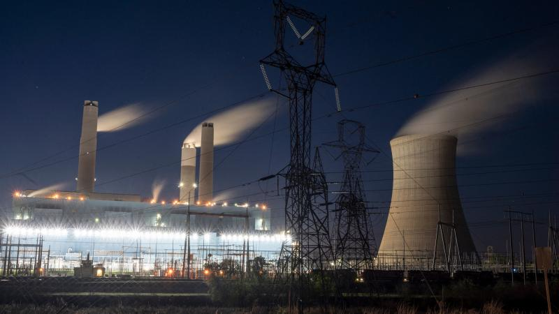 Steam rises from the Miller coal power plant in Adamsville, Ala., in April. An industry group says a climate plan in Congress would shut down all U.S. coal plants by 2030 or earlier.