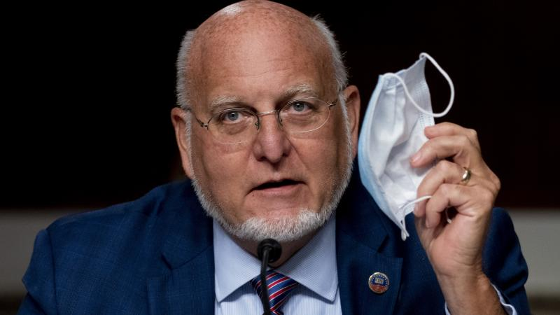 CDC Director Robert Redfield says wearing a mask may provide better protection against COVID-19 than a vaccine.