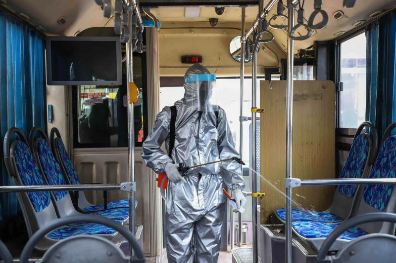 A worker disinfects the inside of a bus in Addis Ababa, Ethiopia. Transit agencies are taking new steps to reduce the risks for riders during the pandemic.