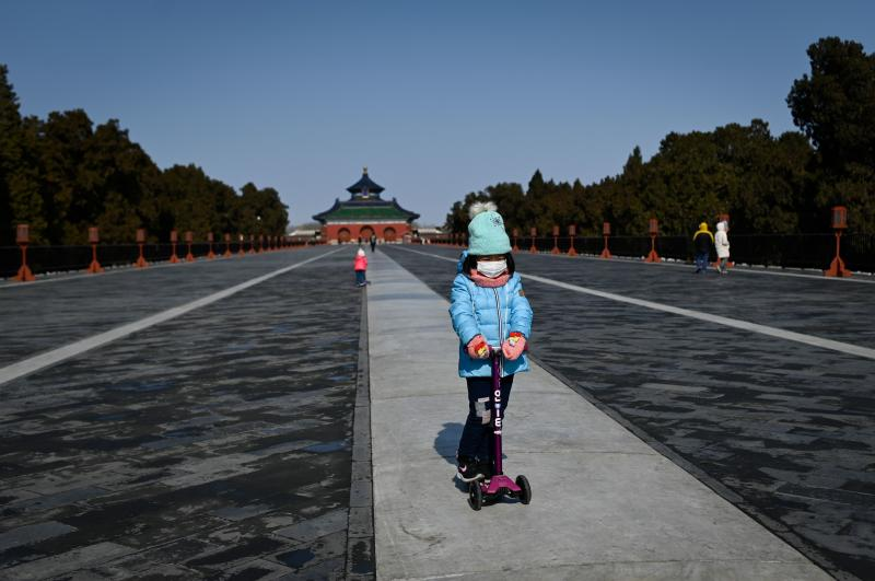 A girl in a park in Beijing on Feb. 15. Researchers are looking at the impact of the newly identified coronavirus on children.