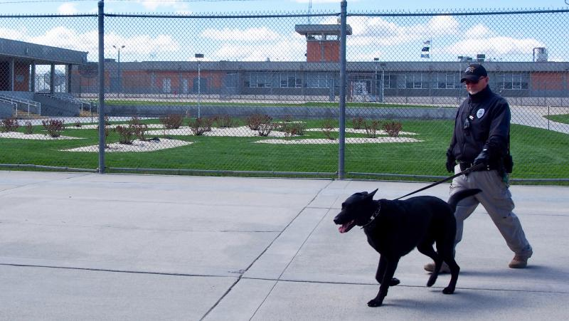 A corrections officer walks the grounds of the Idaho State Correctional Institution south of Boise where Adree Edmo was incarcerated.