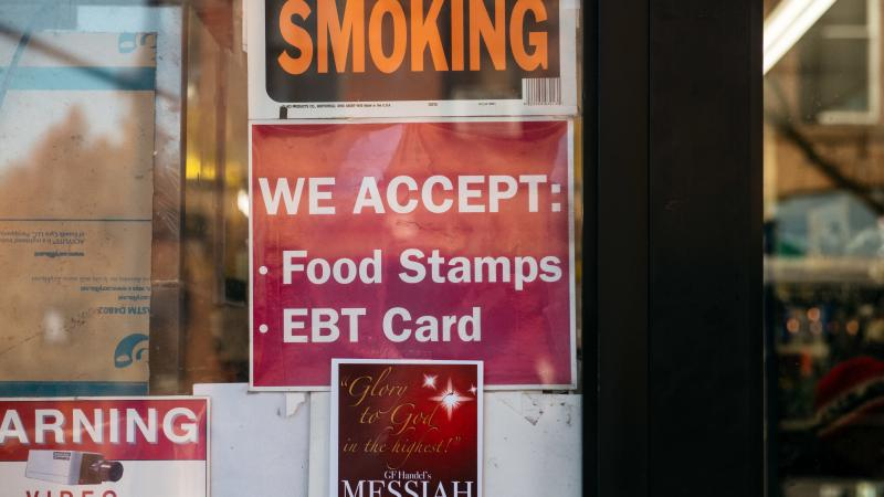 """A judge has tossed out a U.S. Department of Agriculture rule that would have limited food stamps, noting that during the pandemic """"SNAP rosters have grown by over 17 percent with over 6 million new enrollees."""" Here, a sign alerts customers about food stam"""