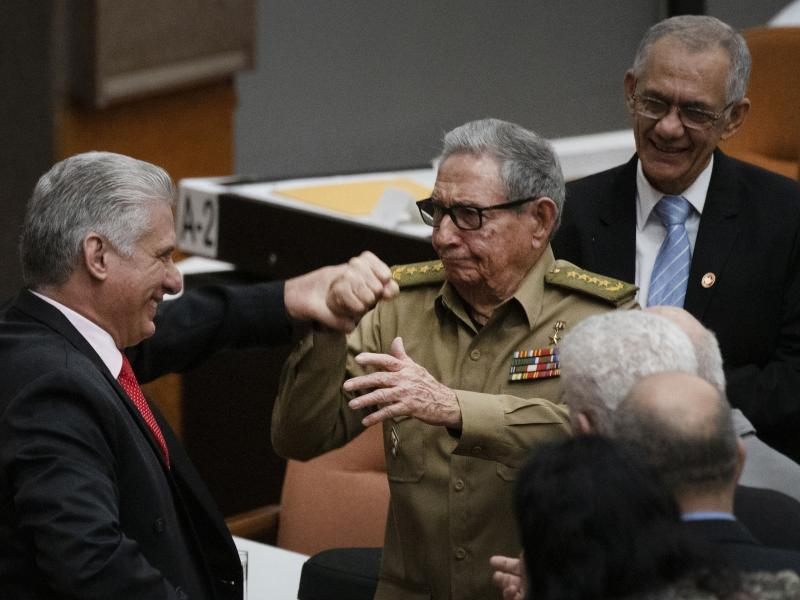 Raúl Castro, first secretary of the Cuban Communist Party and the country's former president, clasps hands with Cuban President Miguel Mario Díaz-Canel Bermúdez during the closing session at the National Assembly of Popular Power in 2019 in Havana.