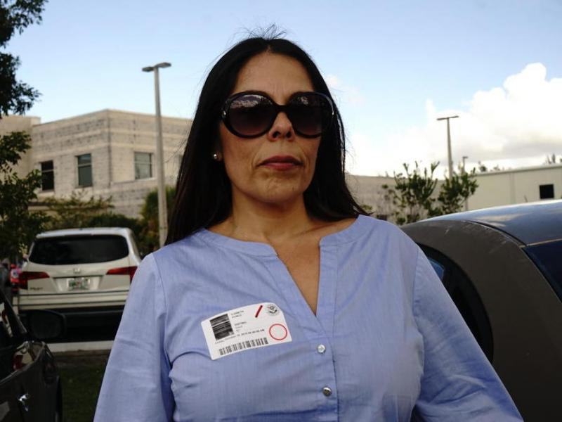 Vianeth Avila outside the courtroom in Miami. Her husband, Cuban-born Jesus Avila, was detained by immigration officials on return from their honeymoon. Avila was a permanent resident, but not a citizen. In recent years, the U.S. government has taken a to
