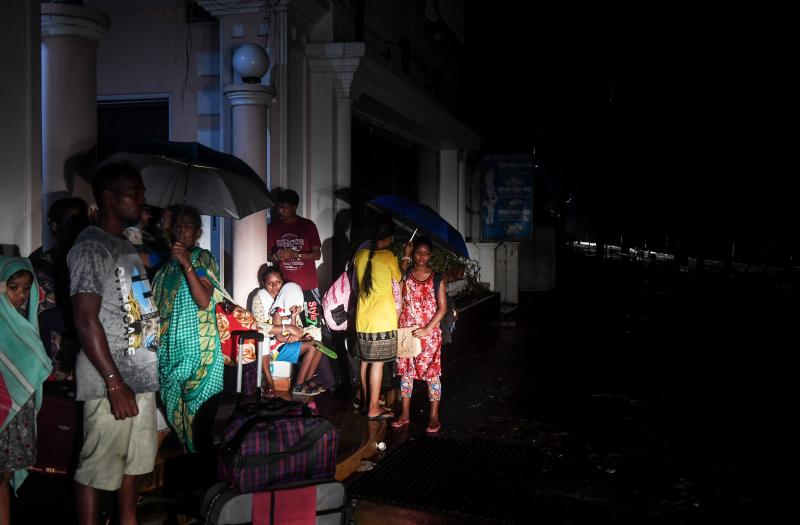 Crowds of people evacuated eastern India ahead of a major cyclone packing strong winds  and torrential rains.
