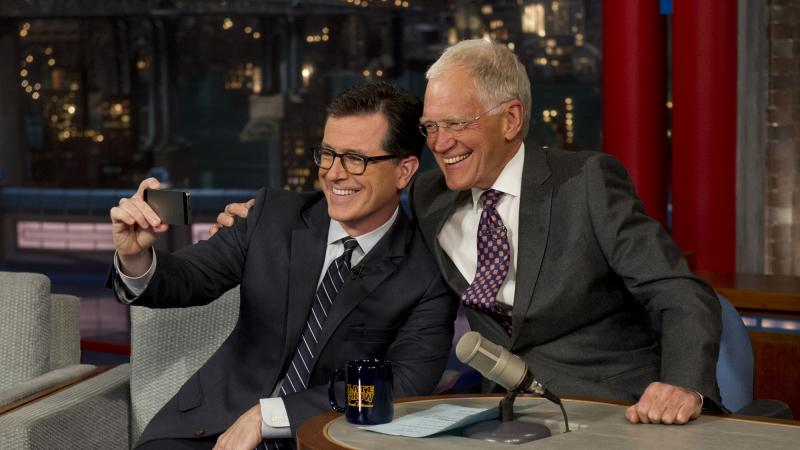 David Letterman, seen here snapping a selfie with his replacement Stephen Colbert, will step down next week as host of the Late Show.