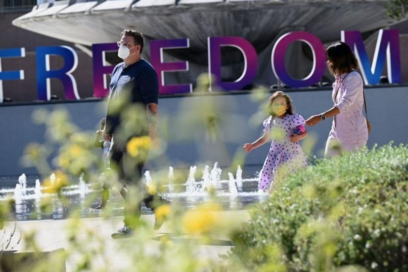 People enjoy an outdoor art exhibition in downtown Los Angeles in early July. Los Angeles County public health authorities are now urging unvaccinated and vaccinated people alike to wear face coverings in public indoor spaces because of the growing threat